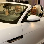Kelly Rutherford and Gary Flom, CEO of Manhattan Jaguar, testing out the new Jaguar F-Type.