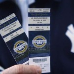 A Yankees fan shows his tickets to the first regular season MLB baseball game between the Yankees and the Indians at the new Yankee Stadium in New York