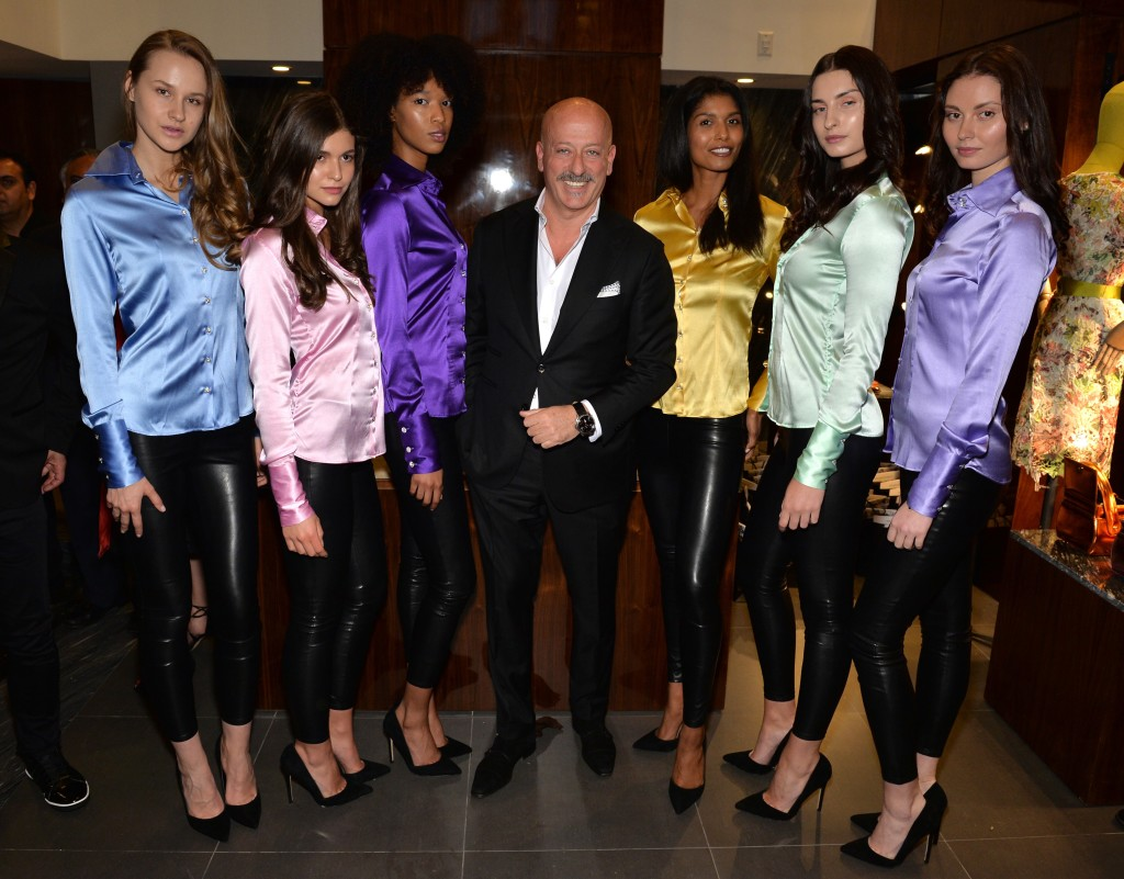 """NEW YORK, NY - MAY 03:  Designer Domenico Vacca poses with models during the grand opening of the Domenico Vacca flagship store on May 3, 2016 in New York City.  (Photo by Andrew Toth/Getty Images for Domenica Vacca)"""